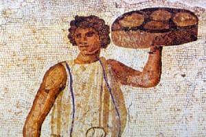 Un servitore dell'Antica Roma serve il cibo in tavola