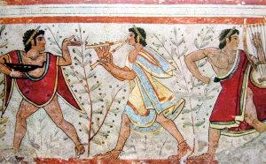Etruschi con piante d'olivo. Per gli Etruschi l'olio d'oliva era anche un medicamento