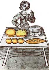 Una donna impasta dei dolci. Il croccante è un antico dolce medievale a tutt'oggi molto apprezzato
