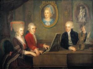 """Wolfang Amadeus e Maria Anna Mozart, detta """"Nannerl"""", si esibiscono al pianoforte alla presenza del padre Leopold"""
